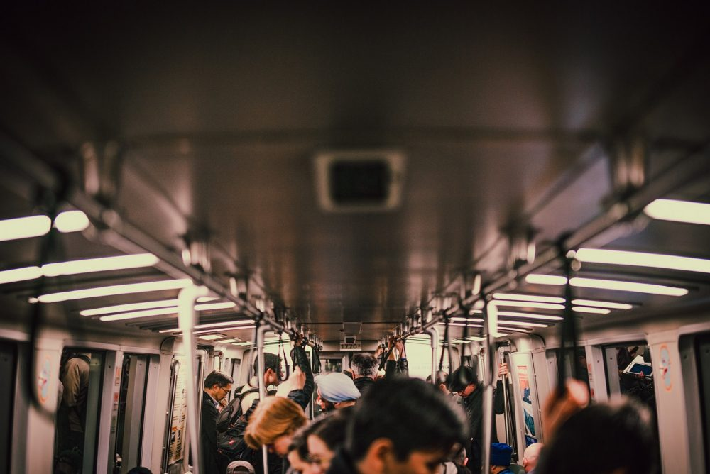 returning to work, commuters on a train going to the office