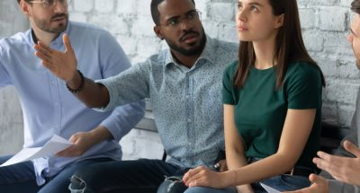 Angry diverse multiethnic applicants argue with confident female before recruitment talk, mad multiracial male candidates discriminate woman intern before interview, gender discrimination concept