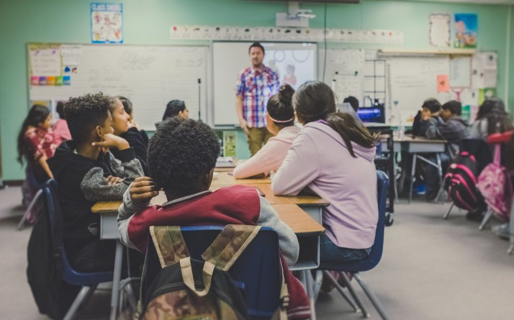 man giving a talk for children in classroom, school, Future First