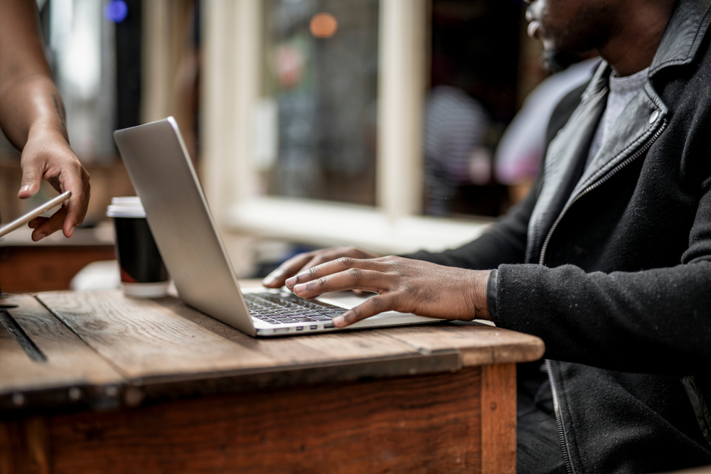 Businessman working remotely from a cafe, flexible working