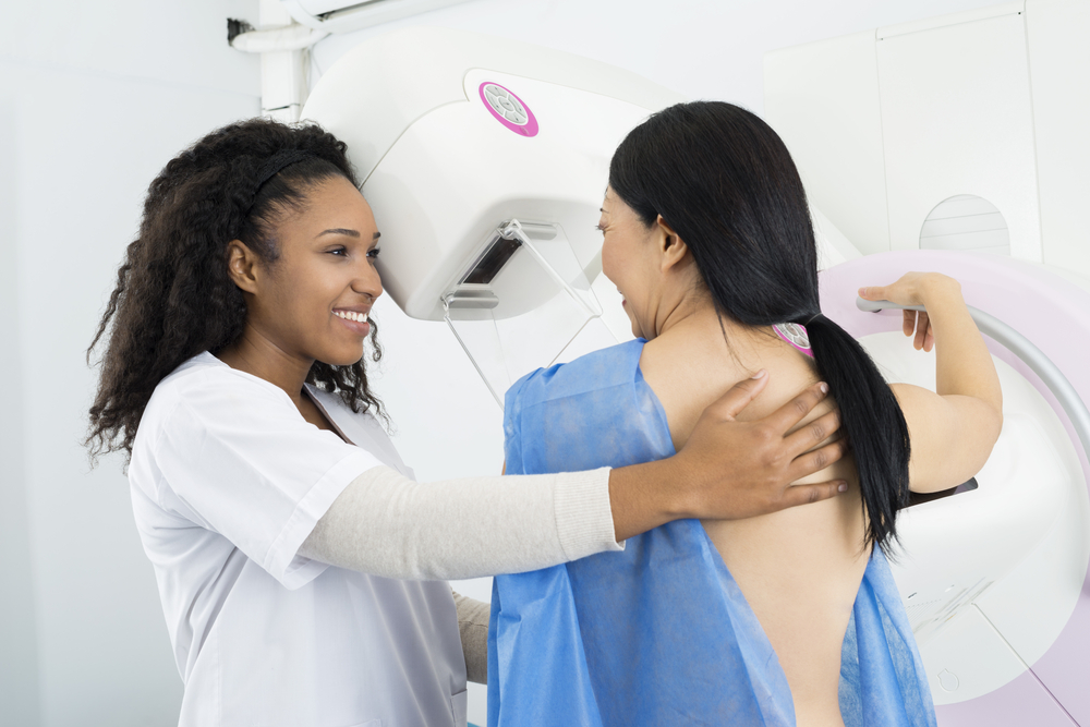 Doctor helping a woman have a breast screening, mammogram