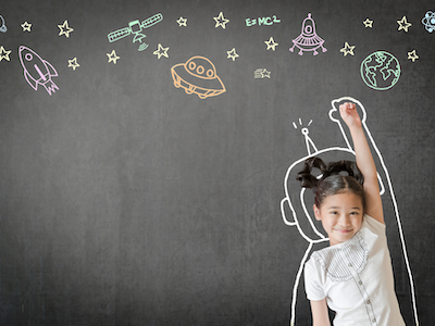 Kid's learning inspiration world in science education with girl child's imagination doodle on teacher's school chalkboard for back to school month and international or universal children's day concep