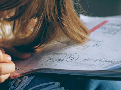young girl doing maths homework