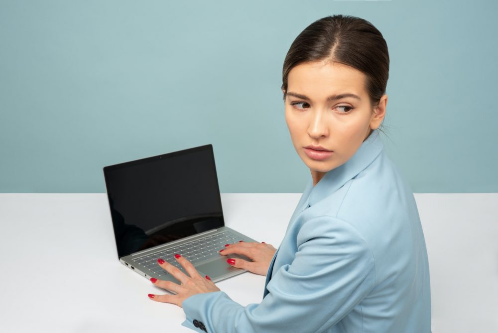anxious woman working from home, job concerns