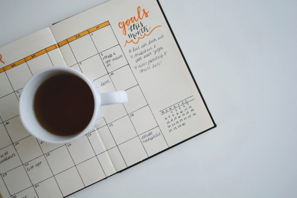 goals, planner with a cup of coffee