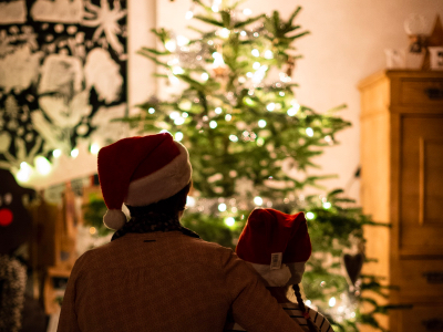 parent and child looking at Christmas tree, work-life balance, festive season