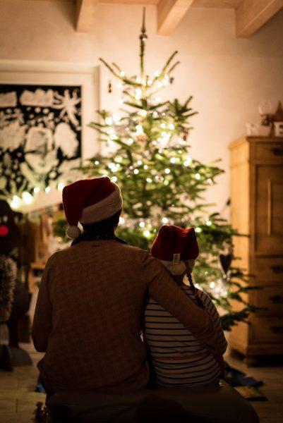 parent and child looking at Christmas tree, work-life balance, festive season