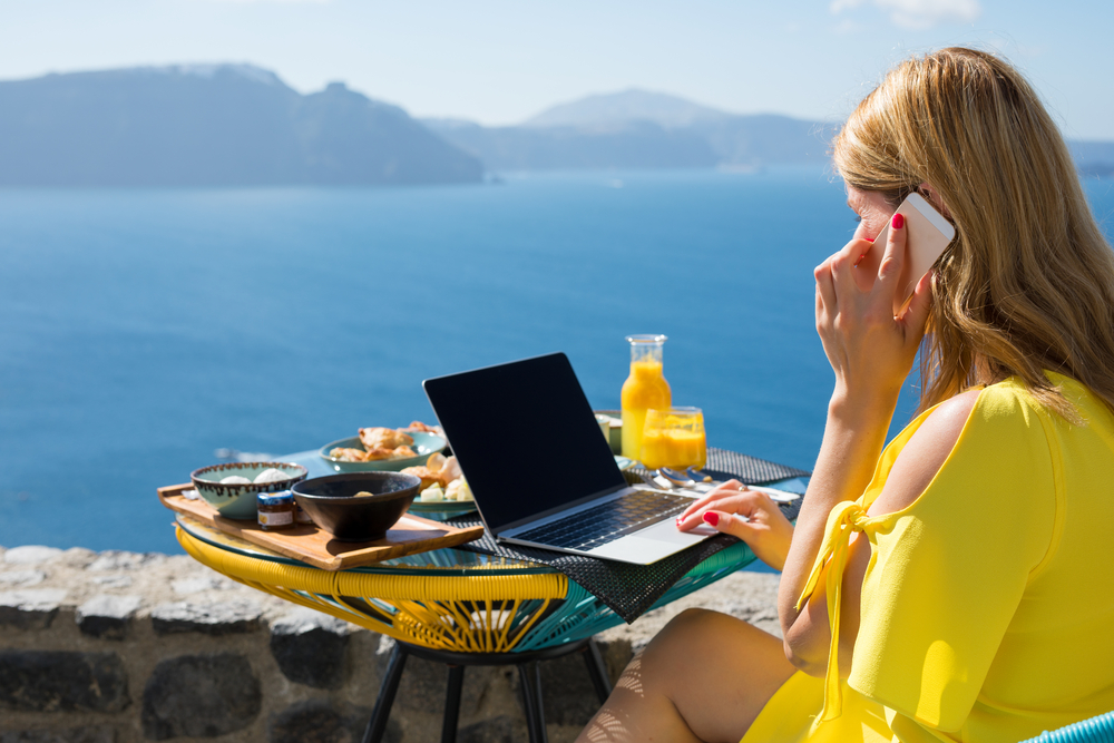 Woman working while on vacation in Mediterranean, work from here
