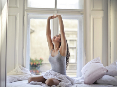 woman waking up in the morning and stretching, embracing your best self, 2021