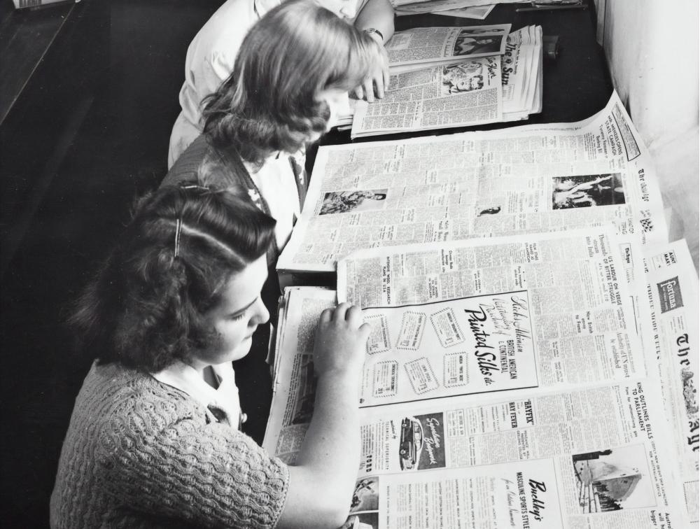 women reading newspapers, news