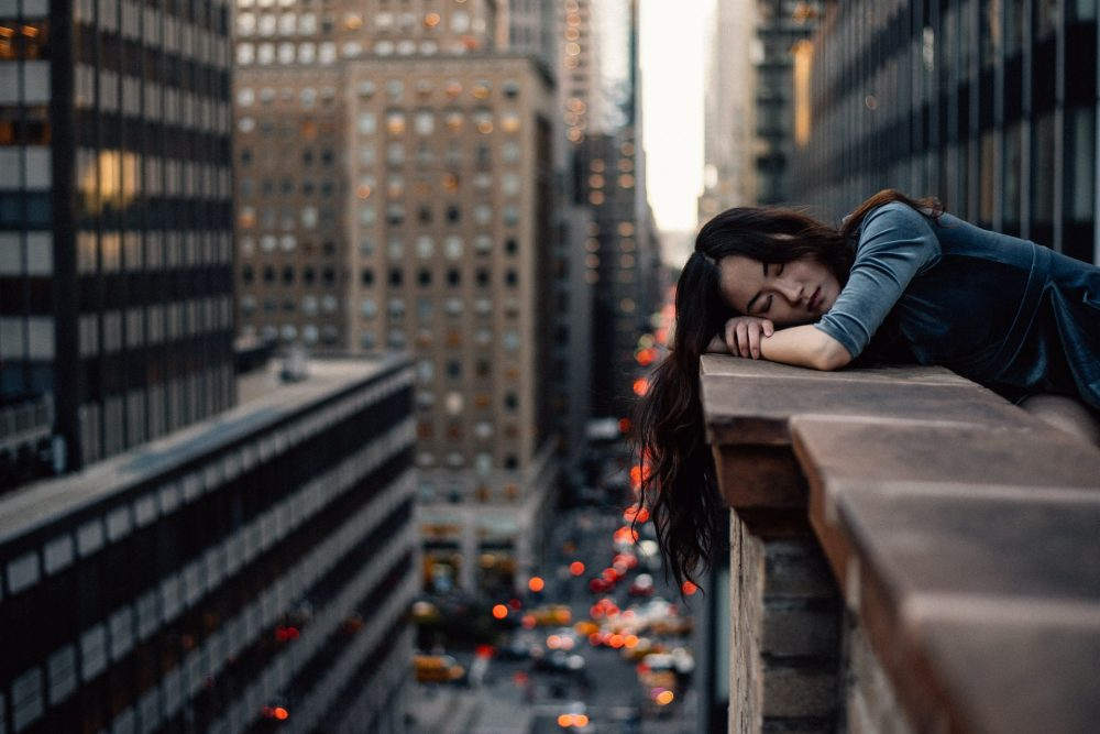 woman lying on wall in New York, lockdown fatigue