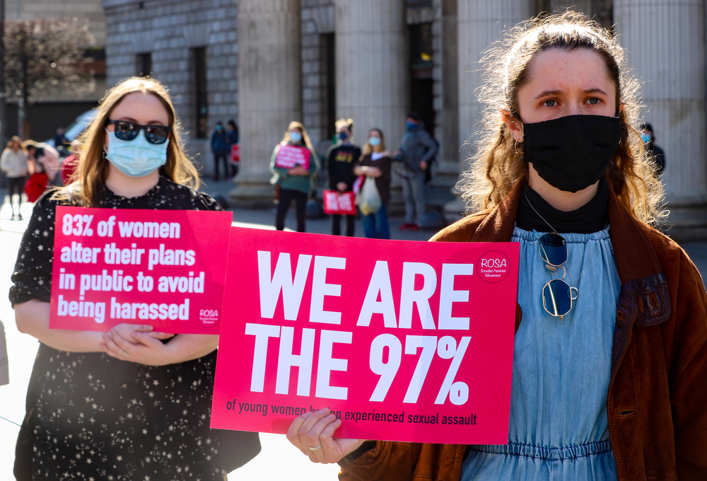 Demonstrators hold up signs at a protest in Dublin to highlight violence against women in the wake of the murder of Sarah Everard, misogyny