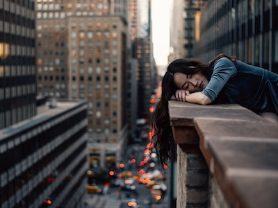 woman lying on wall in New York, lockdown fatigue