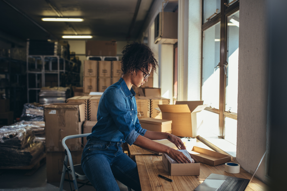 Ecommerce, Female business owner working, packing the order for shipping to customer