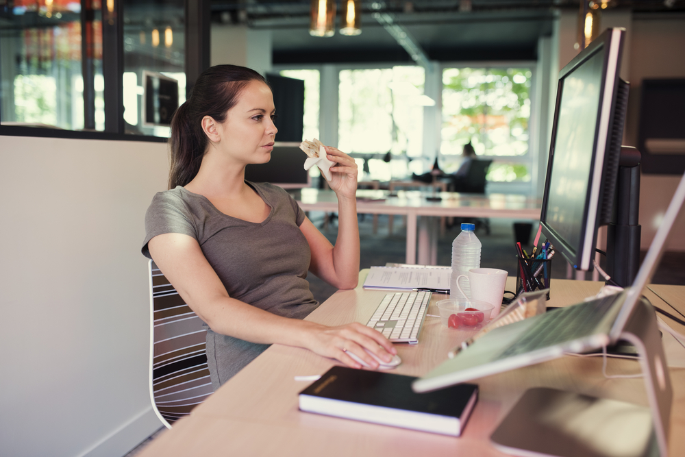 Casual Creative Freelancer Woman Eating A Sandwich In Front Of A Computer, working lunch