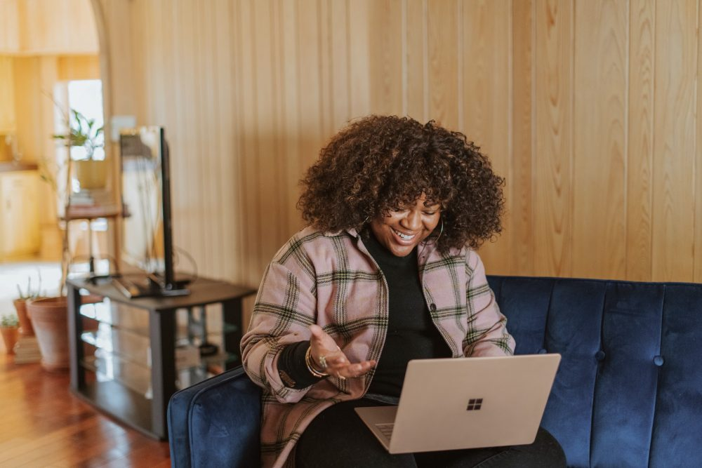 black woman working from home on the sofa, flexible working
