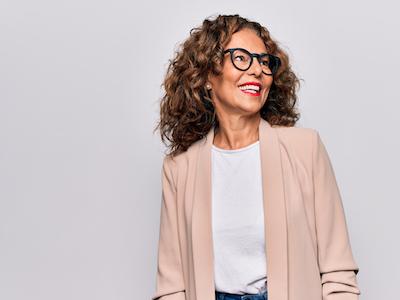 Glamorous, mature lady wearing blazer and glasses, menopauseGlamorous, mature lady wearing blazer and glasses, menopause